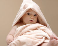 Beautiful baby in a pink blanket Stock Image