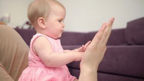 Beautiful baby playing with dad hands. Happy time with father. Sweet childhood stock video