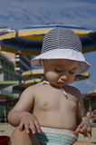 Beautiful baby playing on the sand. In Bulgarian resort Stock Image