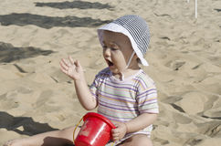 Beautiful baby playing on the sand. In Bulgarian resort Royalty Free Stock Photo