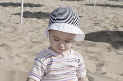 Beautiful baby playing on the sand. In Bulgarian resort Royalty Free Stock Image