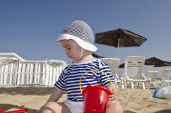 Beautiful baby playing on the sand. In Bulgarian resort Royalty Free Stock Photography