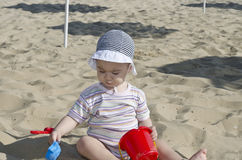 Beautiful baby playing on the sand. In Bulgarian resort Royalty Free Stock Images