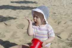 Beautiful baby playing on the sand Stock Image