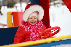 Beautiful baby playing on snow in winter Royalty Free Stock Photos