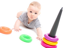 Beautiful baby playing with toys Stock Image