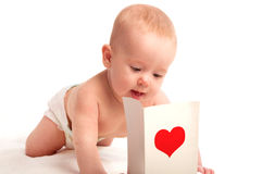 Beautiful  baby and postcard  Valentine's Day with a red heart Royalty Free Stock Photography