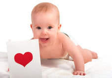 Beautiful  baby and postcard  Valentine's Day with a red heart Stock Image