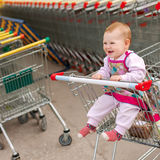 Beautiful baby in shopping cart - trolley Stock Photography