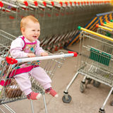 Beautiful baby in shopping cart - trolley Stock Photo