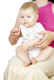 Beautiful Baby sits on her lap Royalty Free Stock Photo
