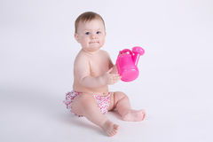 Beautiful baby sitting on the floor isolated Royalty Free Stock Image