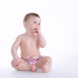 Beautiful baby sitting on the floor isolated Stock Photography