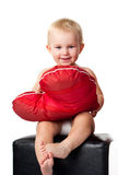 Beautiful Baby Sitting With Heart Shaped Pillow Stock Photos