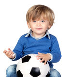 Beautiful baby with a soccer ball Royalty Free Stock Photo