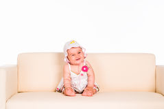 Beautiful baby on sofa Royalty Free Stock Image