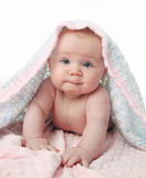 Beautiful baby under a blanket Royalty Free Stock Images
