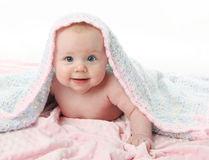 Beautiful baby under a blanket Royalty Free Stock Image