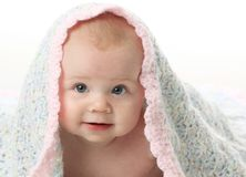 Beautiful baby under a blanket Stock Photography