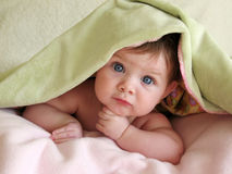 Beautiful baby under blanket stock photos