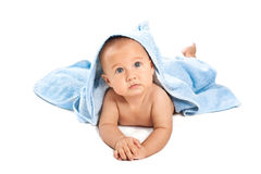 Beautiful baby under blue towel. On white Royalty Free Stock Photography