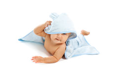 Beautiful baby under blue towel. Isolated on white Royalty Free Stock Photography