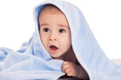 Beautiful baby under the towel after bath Royalty Free Stock Photo