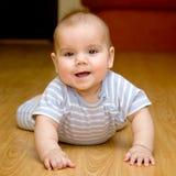 Beautiful baby wearing a striped Stock Image