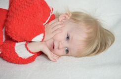 Beautiful baby on a white blanket Stock Photo
