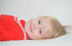 Beautiful baby on a white blanket Royalty Free Stock Images