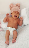 Beautiful baby with wool cap crying Stock Images