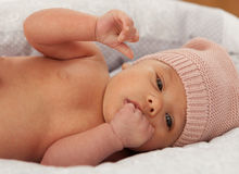 Beautiful baby with wool cap Stock Image