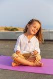 Beautiful baby on the yoga mat Stock Image
