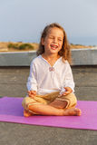Beautiful baby on the yoga mat Royalty Free Stock Images
