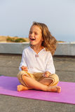 Beautiful baby on the yoga mat Royalty Free Stock Photo