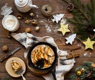 Beautiful background with apple pie. Modern food still life, Christmas holiday card, rustic background Stock Photos