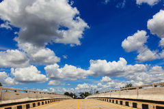 Beautiful background. Beautiful bridge with blue sky and white cloud background Royalty Free Stock Photo