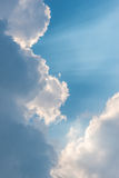 Beautiful background bright sun shines through clouds, light ray Royalty Free Stock Image