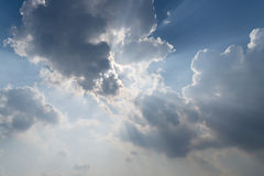Beautiful background bright sun shines through clouds, light rays and other atmospheric effect Royalty Free Stock Photos