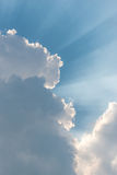 Beautiful background bright sun shines through clouds Royalty Free Stock Images