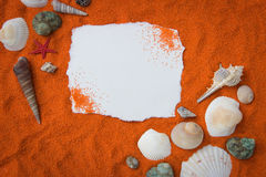 Beautiful background of colored sand, shells, stones and place f Royalty Free Stock Image