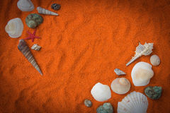 Beautiful background of colored sand, shells, stones and place f Stock Photo