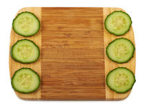 Beautiful background. Cucumber and notepad on wooden cutting board Stock Images