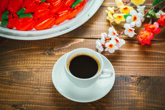 Beautiful background with a Cup of hot coffee with foam and a birthday cake Royalty Free Stock Image