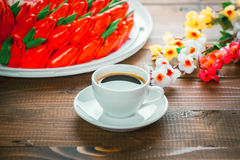 Beautiful background with a Cup of hot coffee with foam and a birthday cake Royalty Free Stock Photos