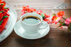 Beautiful background with a Cup of hot coffee with foam and a birthday cake Stock Photos