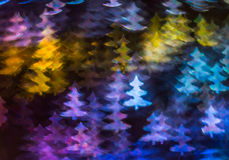 Beautiful background with different colored christmas tree , abs. Tract background, christmas tree  shapes on black background, blurry Stock Photo