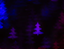 Beautiful background with different colored christmas tree , abs. Tract background, christmas tree  shapes on black background, blurry Royalty Free Stock Images