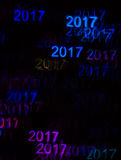 Beautiful background with different colored number 2017, abstrac. T background, year 2017 shapes on black background, blurry Stock Photos