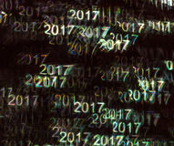 Beautiful background with different colored number 2017, abstrac. T background, year 2017 shapes on black background, blurry Stock Image